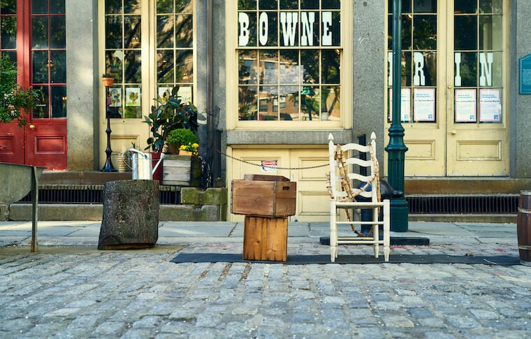 Bowne & Co. Stationers with chair outside